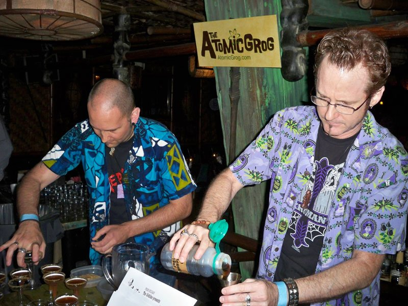Hurricane Hayward (right), with assistance from Nik Satterfield, mixes his Atomic Zombie Cocktail during the Zombie Jamboree at The Mai-Kai in April 2011. (Atomic Grog photo)