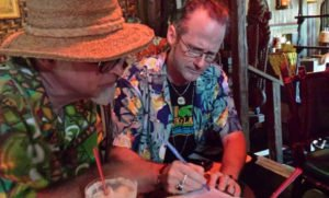 Hurricane Hayward and Beachbum Berry study cocktails in The Molokai bar at The Mai-Kai during The Hukilau 2015. (Photo by Rebecca Cate)