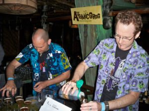 Hurricane Hayward (right), with assistance from artist Nik Satterfield, mixes his Atomic Zombie Cocktail during the Zombie Jamboree at The Mai-Kai in April 2011. (Photo by Susan Hayward)