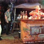 "George Jenkins makes his drink, The Rain Barrel, while emcee Jeff ""Beachbum"" Berry looks on."