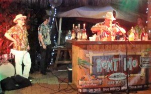 "George Jenkins makes his drink, The Rain Barrel, while emcee Jeff ""Beachbum"" Berry looks on."
