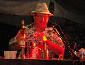 George Jenkins makes his drink, The Rain Barrel.