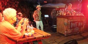 """Pablus makes his drink, Jack Sparrow's Rum Barrel, for emcee Jeff """"Beachbum"""" Berry and the Rum Rat Pack."""