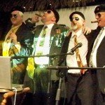 Their mission complete, members of the Rum Rat Pack enjoy victory cigars.