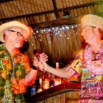 Hukilau emcee King Kukulele (right) introduces Master Mixologist host Jeff &quot;Beachbum&quot; Berry. (Photo by Go11Media.com)
