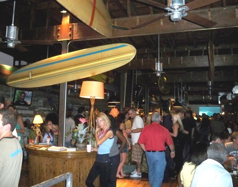 Entering Longboards, you're met with an onslaught of surf decor and a giant center bar (shaped like a surfboard).