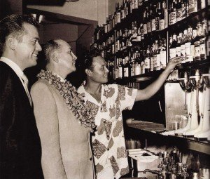 From Sippin' Safari: This vintage photo shows Mariano Licudine displaying his rum collection in 1962.