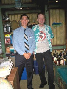 Kern Mattei welcomes Hurricane Hayward in his office, which is loaded with artifacts and (or course) rum. (Photo by Susan Hayward)