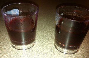 A 50/50 mix of Fee Brothers grenadine and Smucker's Red Raspberry Syrup (left) is compared to Jonathan English brand fassionola. (Photo by Hurricane Hayward, June 2012)