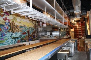A view from behind the bar at Pooch's mural at Kapow! (Photo from KapowNoodleBar.com)
