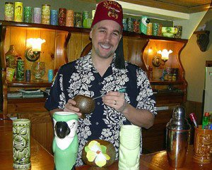 Tiki Brian, host of the Exotic Tiki Island Podcast, behind his Tiki bar