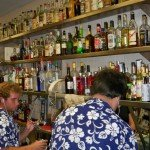 Bartenders are hard at work in The Mai-Kai's kitchen service bar. A total of six bartenders were on duty on a Saturday night, three for each window. (Stop 5)