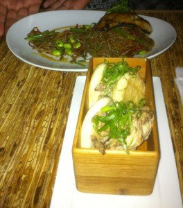 The Crispy Duck Confit steamed buns and Chilled Soba (noodles with broiled black cod) at Kapow! in Boca Raton.