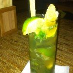 The Ginger Mojito featuring Thai rum, fresh mint, ginger-infused simple syrup and ginger candy garnish.