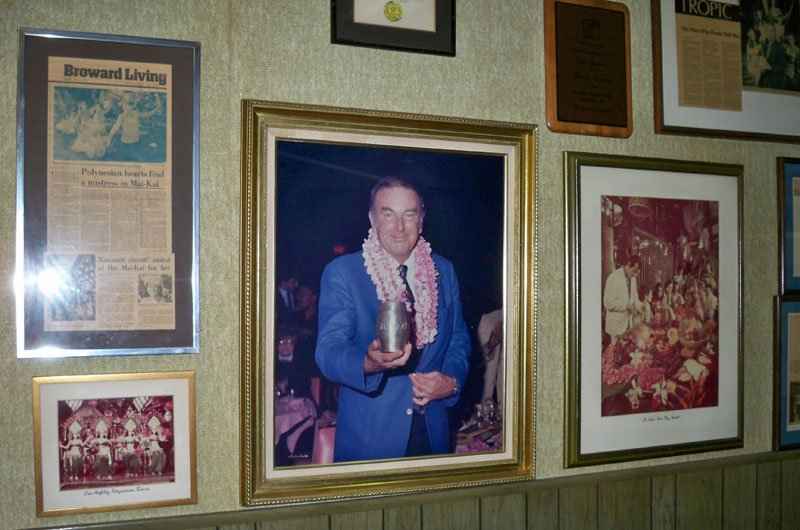Mai-Kai owner Bob Thornton holds a 25th anniversary silver Rum Barrel in a photo that hangs in the center of the back office. (Stop 6)