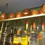Mugs and old Rum Barrels are stashed on a top shelf in The Mai-Kai's Molokai service bar. (Stop 7)