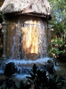 A cascading fountain greets guests in the pre-show area of Walt Disney World's Enchanted Tiki Room (November 2011).