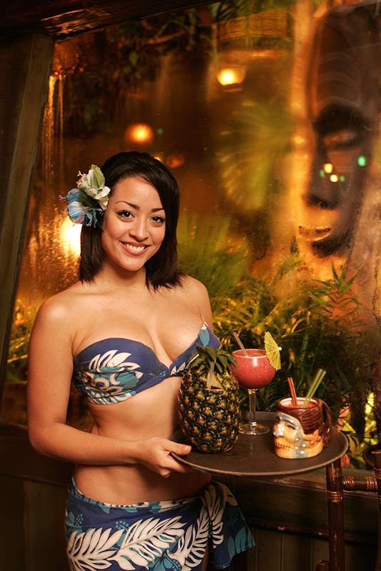 There's nothing more welcoming than a server in The Molokai bar at The Mai-Kai with a tray full of exotic cocktails, including a Piña Passion. (The Palm Beach Post / 2005 file photo)