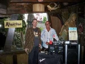The Atomic Grog's Hurricane Hayward confers with DJ Jetsetter.