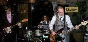 Skinny Jimmy & the Stingrays jam in The Mai-Kai's Molokai bar.