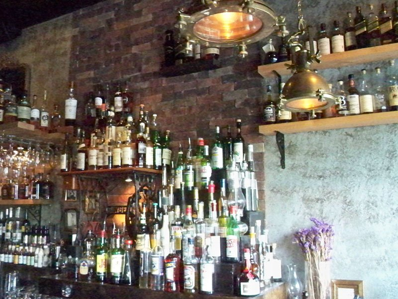 Sweetwater features an eclectic selection of liquors. The vintage lighting and brick walls add to the old-school ambiance.