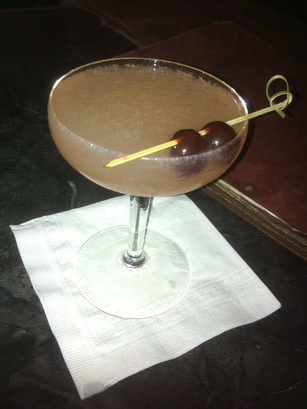 The Papa Double is a daiquiri based on Ernest Hemingway's favorite drink, garnished with two brandied cherries.