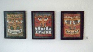 A trio of Wayne Coombs paintings.