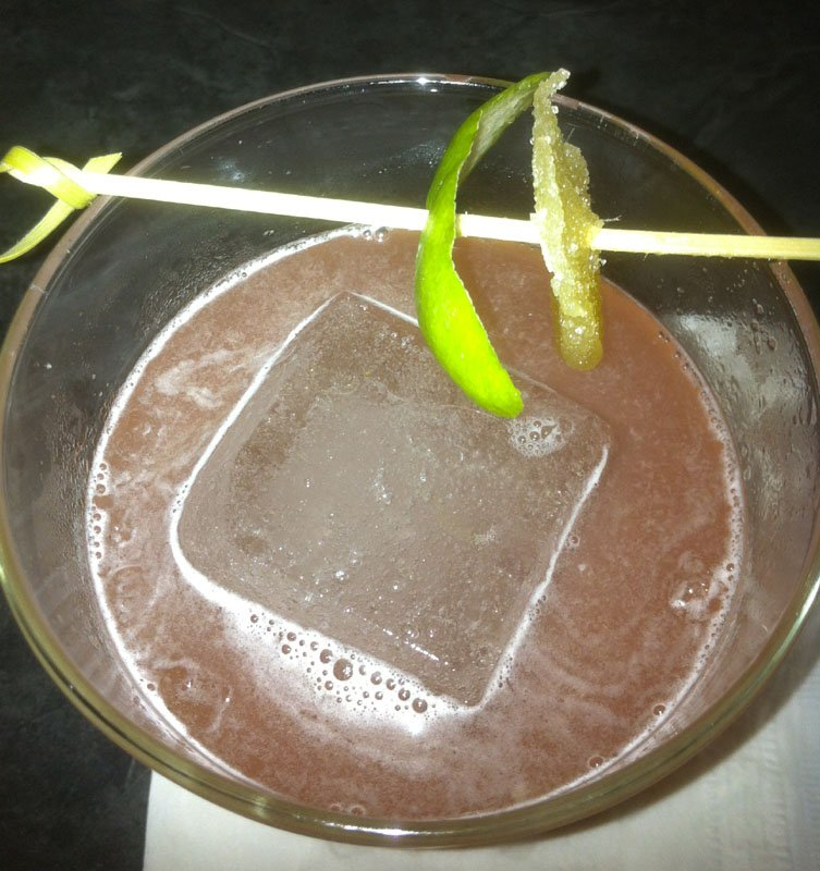 One large ice cube is used in the Skinny Dip and other cocktails as a better method of keeping drinks cold with minimal dilution.