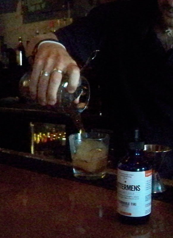 After shaking the rum and other ingredients with small ice pebbles, Iglehart pours the drink into an old-fashioned glass with a large cube.