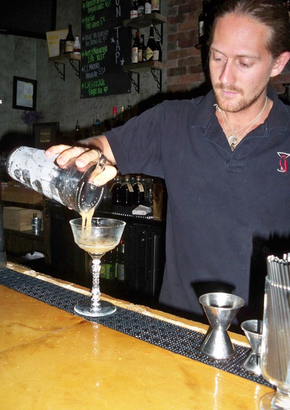 Sean Iglehart pours a Fudgepacker, a unique cocktail containing English chocolate walnut fudge-infused Johnny Walker Red Label whiskey.