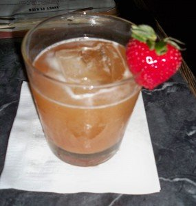 The Whiskey Ultimatum's garnish matches one of its unusual ingredients, strawberry rhubarb jam.