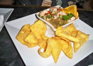 Mojito Shrimp Ceviche with tostones and crispy fried plantains.