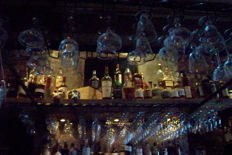 Some of the more obscure bottles are hidden away above the bar.