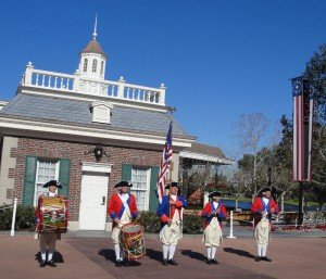 The Spirit of America Fife &amp; Drum Corps performs outside The American Adventure in December 2011.