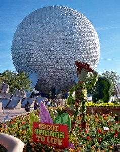 "A topiary of Woody from ""Toy Story"" guards Spaceship Earth during Epcot's Flower and Garden Festival, March 2011."