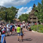 Crowds walk the World Showcase promenade near the Norway pavilion.