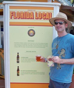 Hurricane Hayward, a proud Floridian, shows off his festival passport as he enjoys a beer at the Florida Local marketplace.