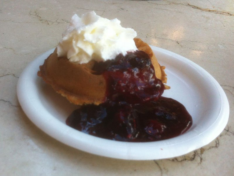 The Belgian Waffle with Berry Compote and Whipped Cream is a signature item at the Belgium booth.