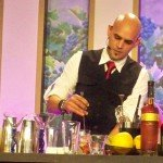 Freddy Diaz mixes up his first cocktail, a Xanté Old Fashioned, in the Epcot International Food and Wine Festival seminar presented by the Peter F. Heering Co.