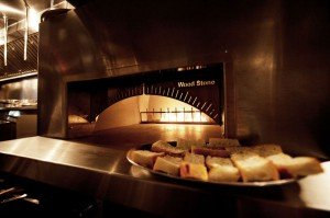 The open kitchen's wood-burning oven