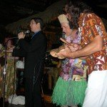 "Mai-Kai general manager Kern Mattei leads the crowd in sing-along of his new ""Hukilau Song"" (aka ""Rum in Your Mouth"") with a little help from King Kukulele and Crazy Al (right) as Hukilau organizers Stacie ""Heelgrinder"" Herndon (left) and Christie ""Tiki Kiliki"" White look on."