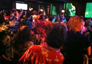 Colorfully-clad attendees of The Hukilau pack the Wreck Bar for the late-night Pearl Dive show