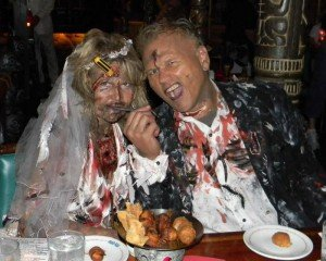 A zombie couple gnaws on a Pupu Platter at last year's Hulaween