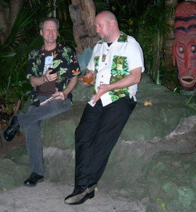 Martin Cate fields Hurricane Hayward's questions while he enjoys a Mutiny in The Mai-Kai's Tiki gardens