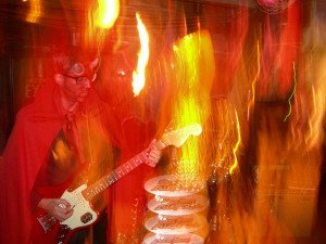 Skinny Jimmy is the God of Hellfire while jamming in The Molokai lounge