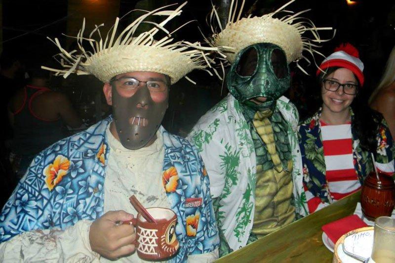 A festive Hannibal Lecter enjoys a Shrunken Skull (what else?) while the Sleestak seems to prefer the Barrel O' Rum