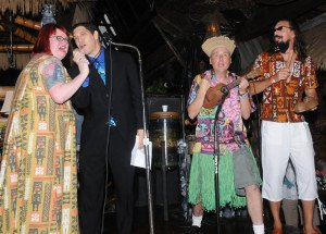 "Organizer Christie ""Tiki Kiliki"" White breaks out in song with Mai-Kai manager Kern Mattei, and longtime event performers King Kukulele and Crazy Al Evans during The Hukilau in June 2013"