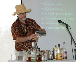 Beachbum Berry mixes up a cocktail during a symposium at The Hukilau in June 2010