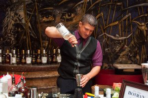 A mixologist shows off a Botran rum cocktail during the 2013 festival
