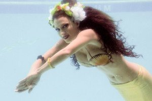 Marina the Fire Eating Mermaid performs in the pool at the Yankee Clipper during The Hukilau in June 2013